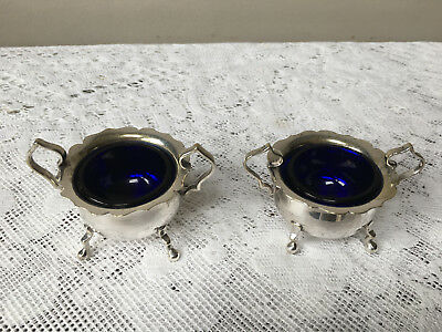 Pair of decorative vintage silver plated salts with blue liners