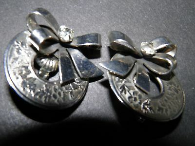 silver tone circle of life with bow  clip on earrings
