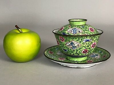A Chinese Canton enamel green ground tea bowl, lid & stand trio 19th/20thc
