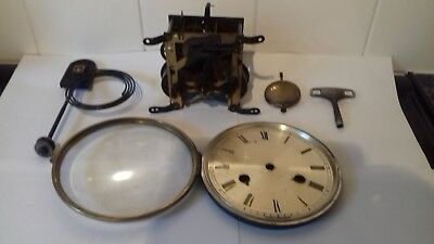 vintage brass wind up chiming clock movement  (complete)