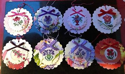 8 hand crafted floral cross stitched completed gift tags. Card toppers