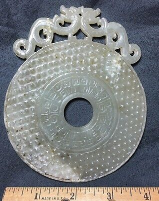 Chinese Carved Green Jade Shang or Liangzhu Bi Disc with Dragon at top.