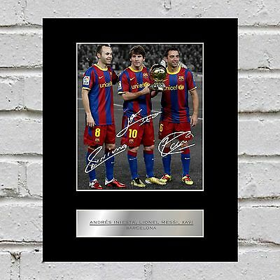 Andrés Iniesta, Lionel Messi, Xavi  Signed Mounted Photo Display Barcelona FC