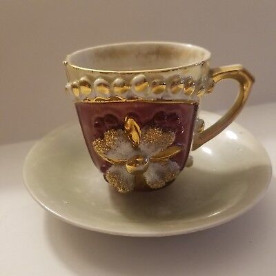 Vintage/Antique Raised Florals Tea Cup & Saucer