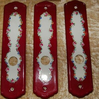 Set of three handpainted French porcelain ceramic door backplates flowers