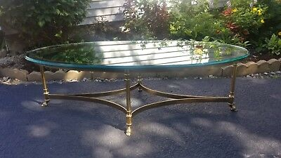 La Barge solid brass and glass coffee table. Oval Footed Hoof. 51x26