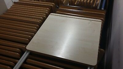folding exam desks, used but in good condition. Metal framed with wooden top.