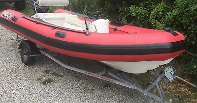 Valiant Rib with 60 HP Evinrude and Road trailer