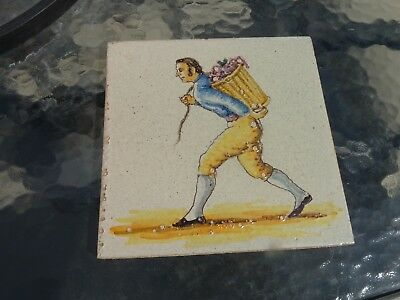 ANTIQUE HAND PAINTED TILE WITH MAN CARRYING BASKET CIRCA 1780s
