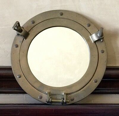Vintage Solid Brass Porthole Wall Mirror in excellent condition!