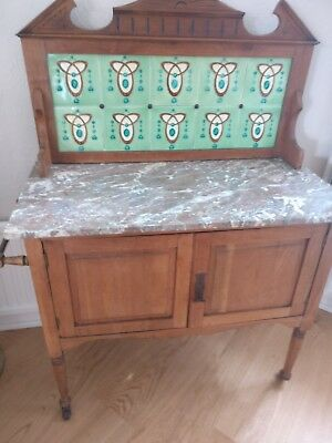 antique marble top wash stand with art deco style tiles to splash back