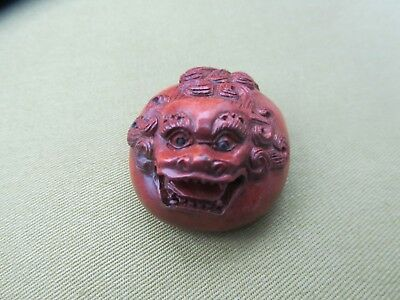 An appealing fat dragon with glass eyes signed netsuke