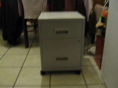 Home or office 2 draw  filling cabinet with wheels and key.