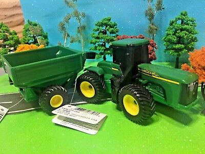 JOHN DEERE, ERTL, Farm Toy Tractor 8760 Four Wheel Drive Tractor & feed wagon