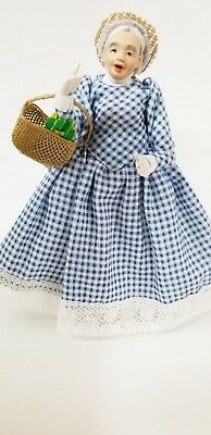Sweet Faced Old Lady Dressed In Blue Gingham With Basket