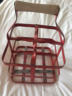 Vintage metal four bottle carrier painted red