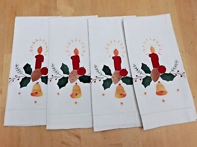 Four vintage Christmas napkins with red candles and holly