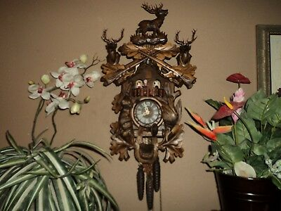Beautiful German Black Forest Carved  Musical Cuckoo Clock With Dancers