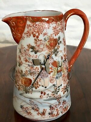 Japanese Kutani Jug / Pitcher decorated with figures and blossoms, signed,12.5cm