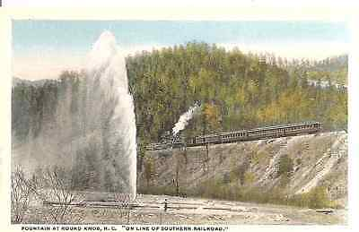 Old postcard,Fountain at Round Knob NC,Southern Railroad train on tracks above