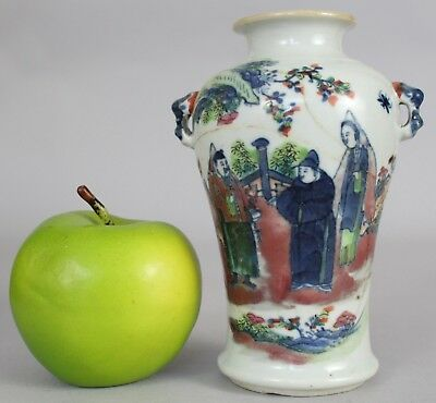A Chinese underglaze red figural vase with handles 19thc Qing