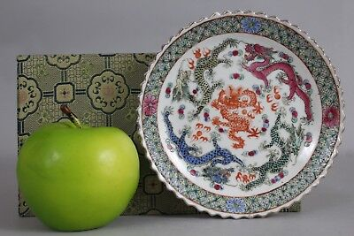 A Chinese famille rose 'nonya-type' dragon dish with Qianlong mark 20thc
