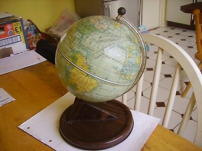 Vintage Chad Valley world earthly globe dating to the 1960s with time element.