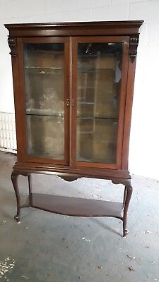 Victorian mahogany cabinet on stand with glass shelves and one key