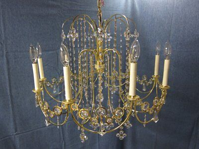 Large vintage brass and crystal empire chandelier. Also have matching small one!