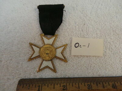 WW 2 or Earlier Womans Auxillary Corps Medal,  Oc-1