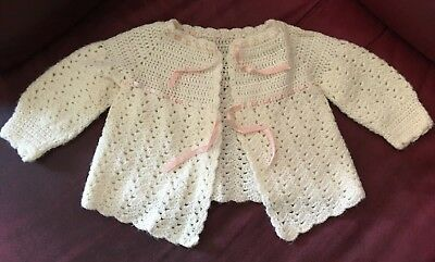 Vintage early 1960s baby girl knit sweater, cream color with pink ribbon