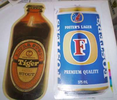 TWO  old beer advertising stickers  Tiger Stout and Fosters (25 cms high)