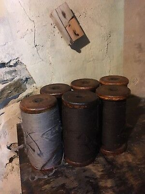 "Antique 7"" woolen mill spools/spindles"