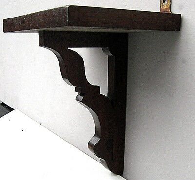George III/George IV mahogany or tropical rosewood wall/clock bracket