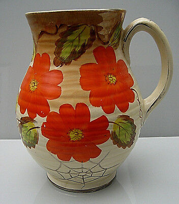 Arthur Wood art pottery jug with painted orange flowers and spider's web