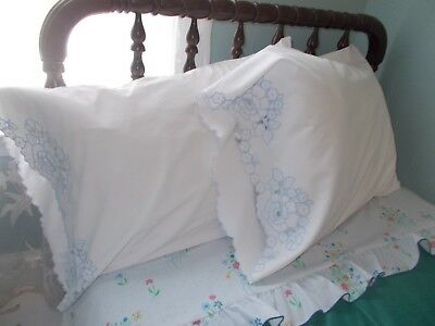 Vintage pair of fine-quality Italian linen cutwork and embroidered pillowcases