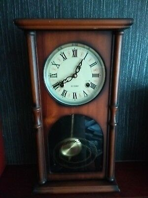 Antique wooden 31 day chiming wall clock, working order.