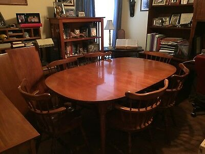 1962 Sprague and Carleton hard-rock maple table with two leaves & six chairs.