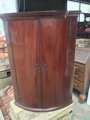 George III period Mahogany bow fronted corner cabinet