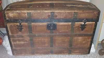 Antique wooden humpback steamer trunk