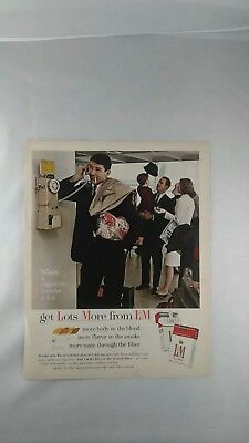 1964 L&M cigarette ad of man talking on rotary dial page phone.
