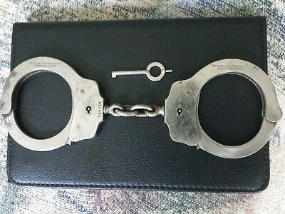 80 year old Vintage Model 3 (ver. 2) Peerless Handcuffs with Peerless key