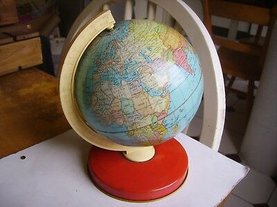 Collectible vintage tin plate world globe by Chad Valley dating to 1960s.