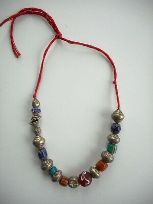 Strand of Small Silver and Trade Beads Collected in Indonesia