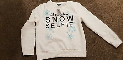 girls white christmas sweatshirt with motif on the front for size 15 years