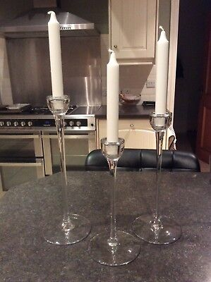 3 IKEA glass candle stick holders with brand new white candles