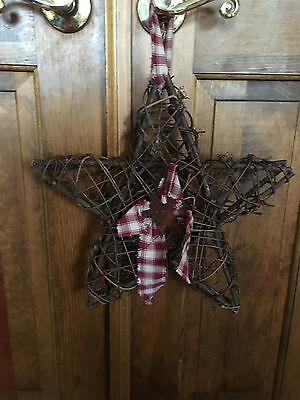 "GRAPEVINE COUNTRY CHRISTMAS STAR - 14"" Fabric and rusted tin."