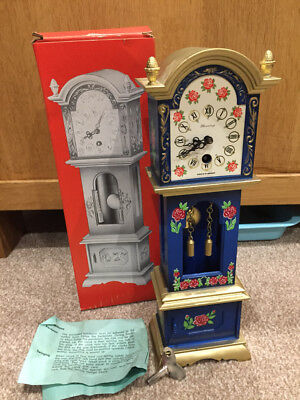 Vintage Novelty Clock Excellent. German make with key and Pendulum.