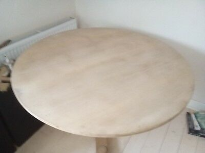 large circular arts and crafts  dining table