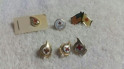 6 Red Cross pins, 3Blood Donor 2,3,9 Gallon,volunteer, US flag , and 1 more